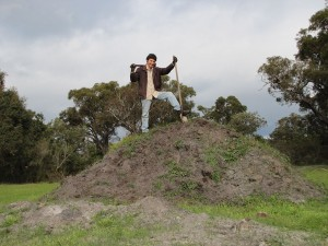 Brett standing on top of a mound of topsoul